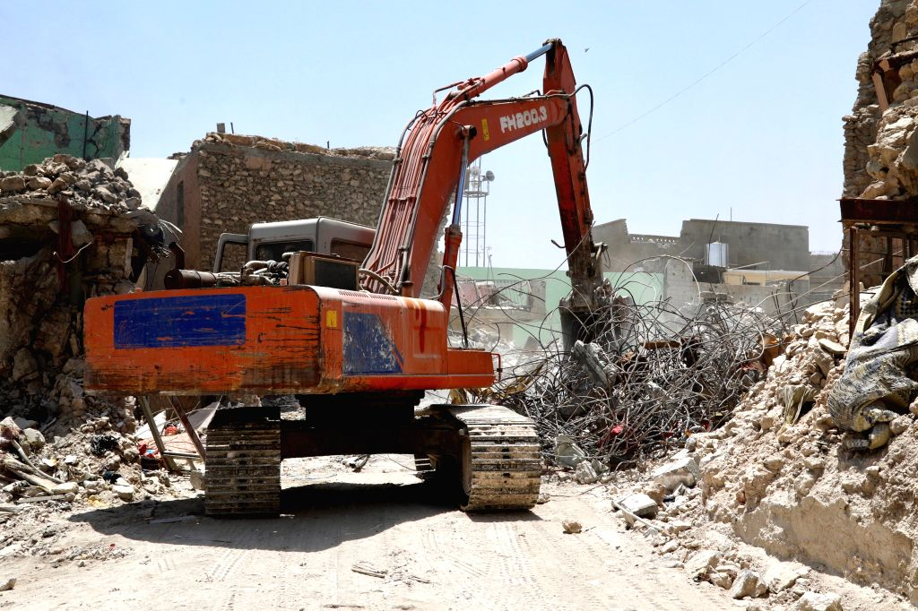 MOSUL, July 10, 2018 - An excavator cleans the ruins of collapsed buildings in the old city of Mosul, Iraq, July 5, 2018. One year after the Iraqi forces liberated the city of Mosul from Islamic ...