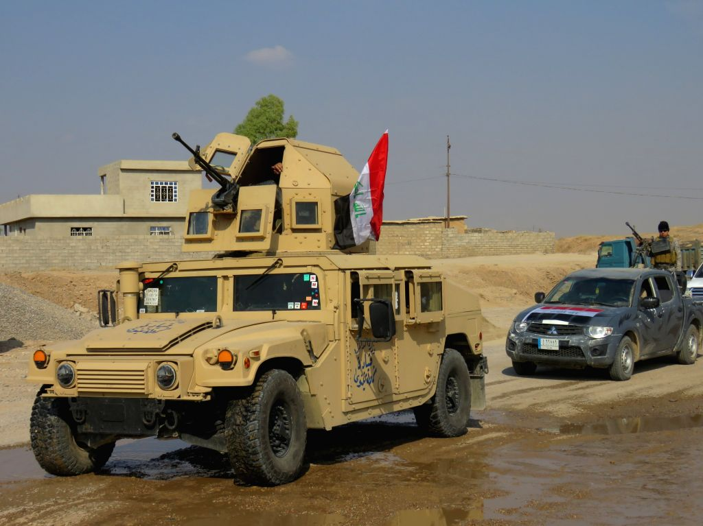 MOSUL, Oct. 26, 2016 - Iraqi soldiers reinforce to guard the Bartella frontline, east of Mosul, Iraq, on Oct. 26, 2016. Iraqi security forces on Wednesday inched to the eastern fringes of the city of ...