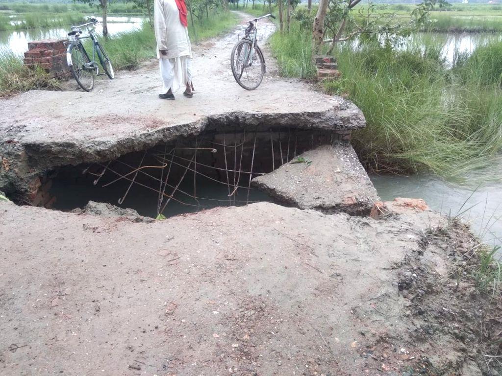 Motihari: A road damaged by floods in Motihari, Bihar on July 13, 2019. (Photo: IANS)