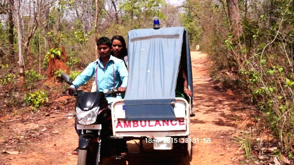 Motorcycle Ambulance carrying a patient inside.