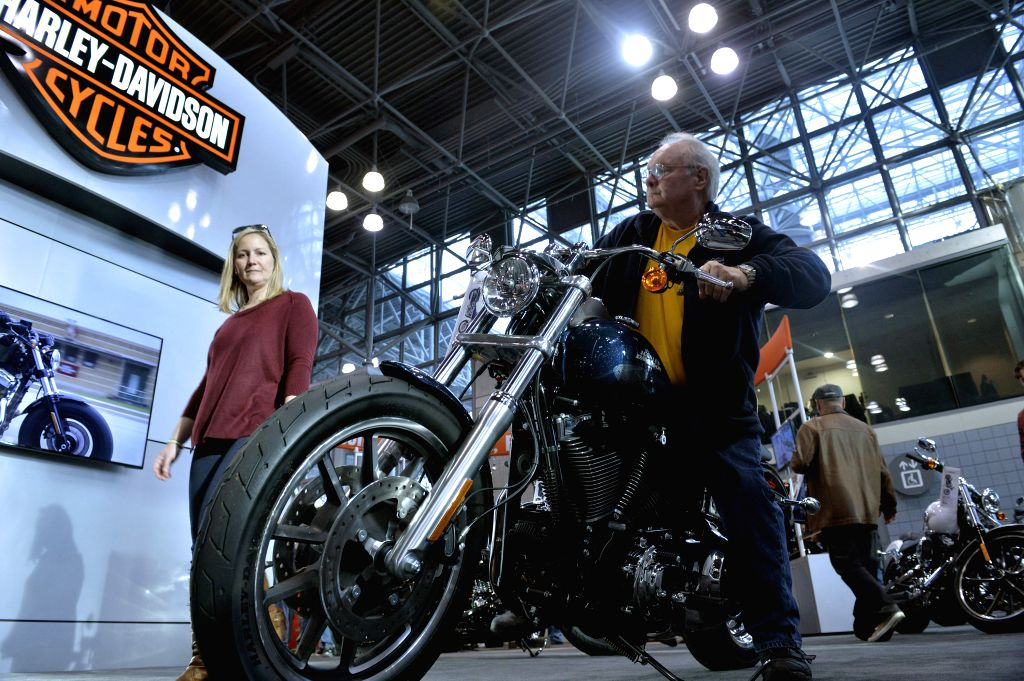 Motorcycle fans visit New York International Motorcycle Show in New York, the United States, on Dec. 11, 2015. New York International Motorcycle Show is a 3 day ...