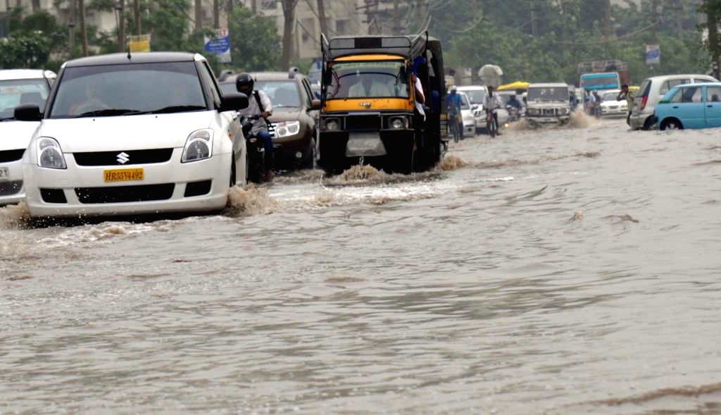 Motorists struggle through a water-logged road of Gurgaon on June 28, 2016.
