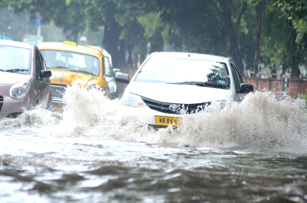 Motorists struggle through water-logged streets of Kolkata, on July 3, 2016.