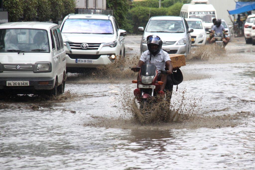 Motorists struggle through water logged streets of Gurugram on June 20, 2017.