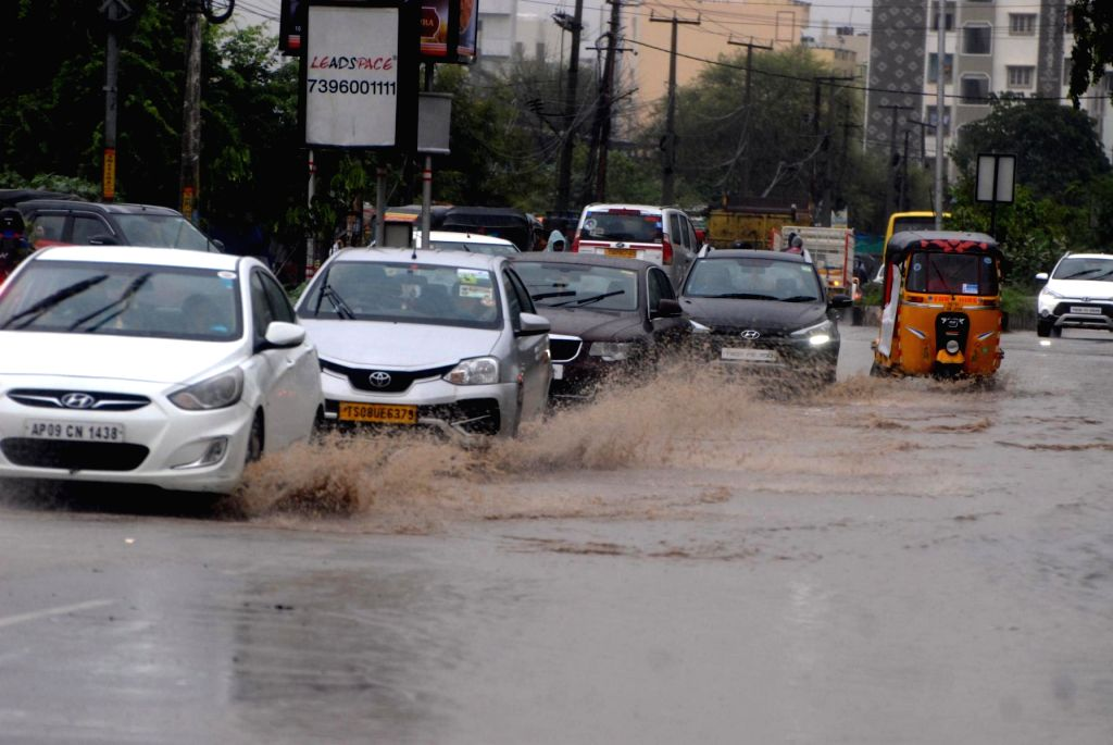 Motorists struggle through water logged streets of Hyderabad after heavy rains on Aug 2, 2019.