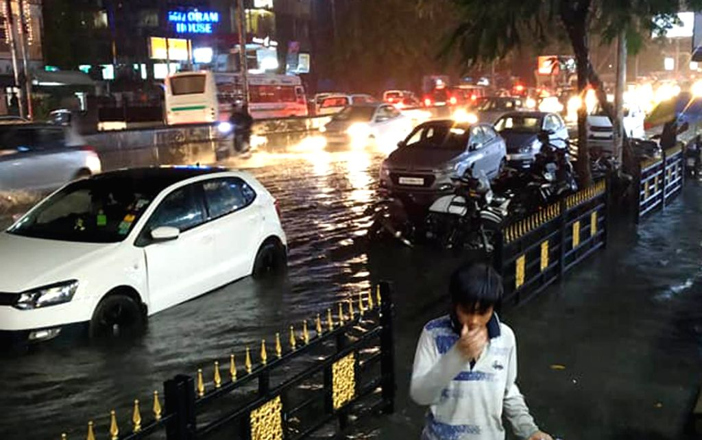 Motorists struggle through waterlogged streets of Guwahati on June 3, 2019.