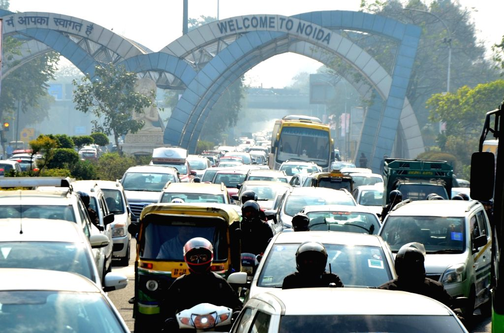 Motorists stuck in a traffic jam near Delhi-Noida border due to a Congress rally against alleged scam in Rafale deal on Jan 30, 2019.