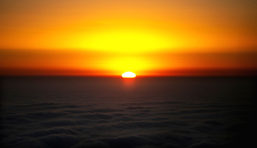 MOUNT EMEI, Dec. 29, 2019 - Photo taken on Dec. 29, 2019 shows the sunrise on the summit of Mount Emei, or Jinding in Chinese, in southwest China's Sichuan Province.