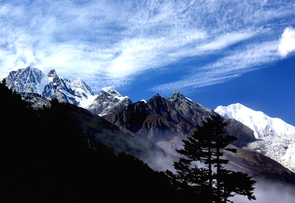 Mountains and trees are seen at Hailuogou National Glacier Forest Park in southwest China's Sichuan Province, Oct. 28, 2015. Hailuogou (Conch Gully) National ...