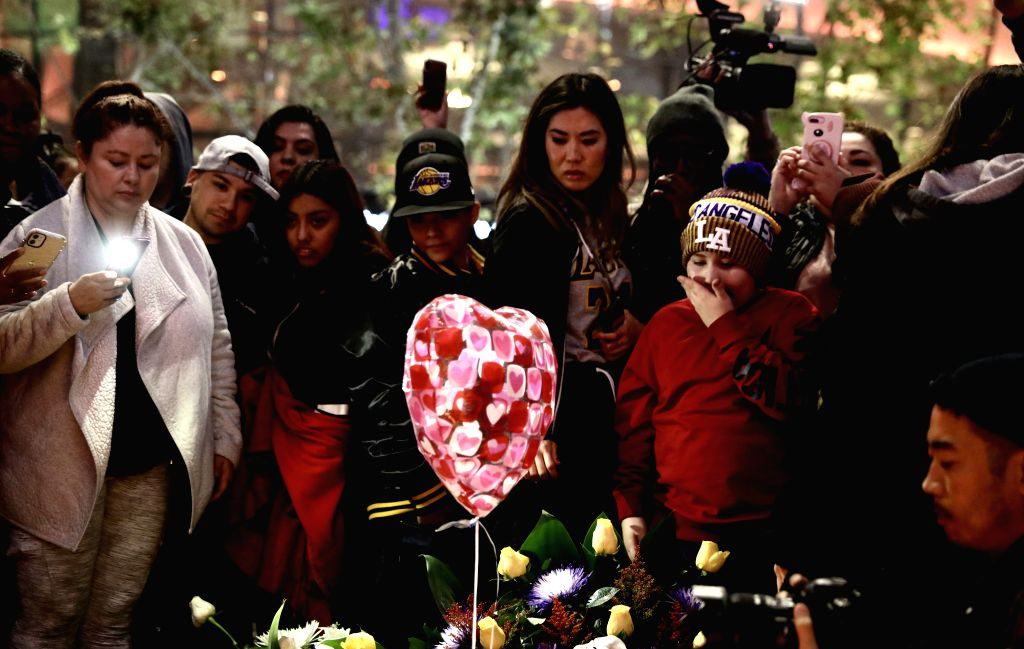Mourners gather near the Staples Center to pay respects to Kobe Bryant, in Los Angeles, California, the United States, on Jan. 26, 2020. Retired NBA star Kobe ...