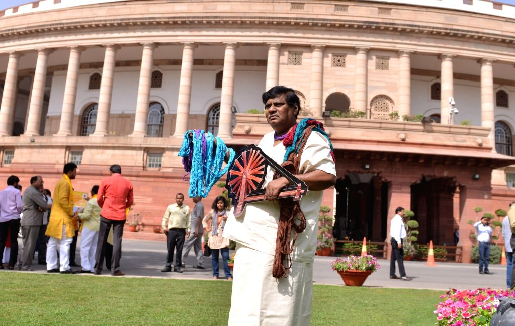 MP Siva Prasad stage a demonstration at Parliament on March 27, 2018
