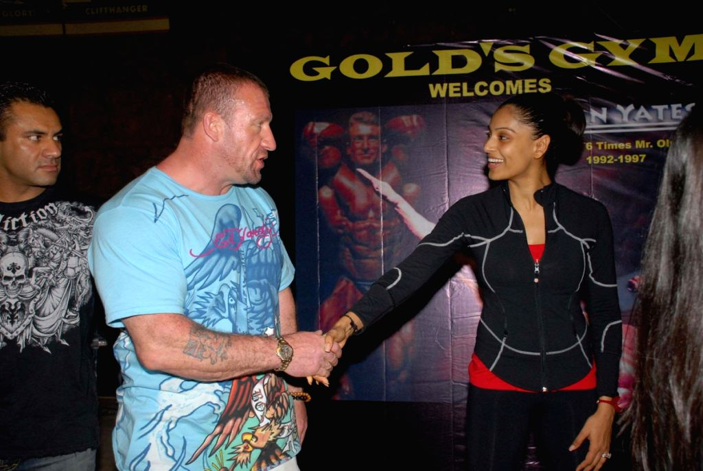 Mr. Olympia title winner Dorian Yates at Gold Gym with Dino Morea and Bipasha.
