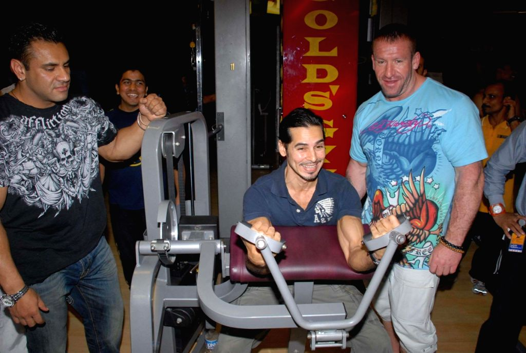 Mr. Olympia title winner Dorian Yates at Gold Gym with Dino Morea.