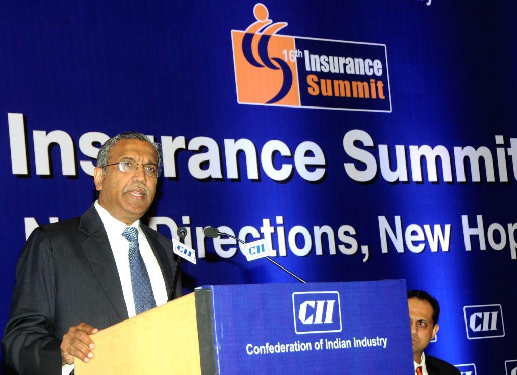 Mr T S Vijayan, Chairman, IRDA addressing at 16th CII Insurance Summit in Mumbai 14th August 2013. (Photo::: IANS)