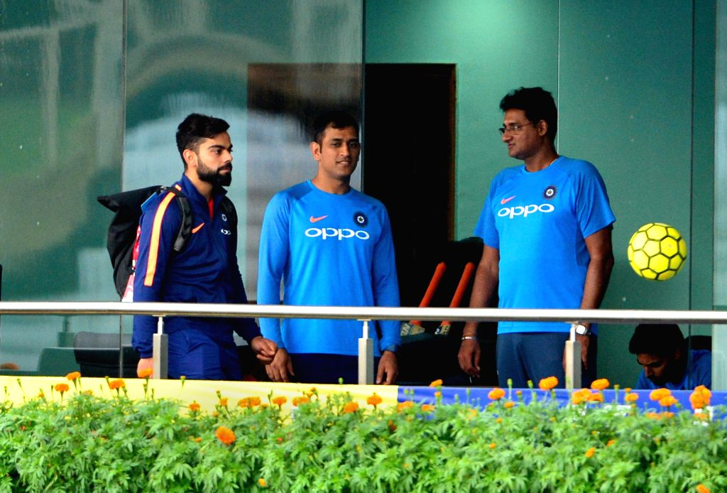 MS Dhoni and Virat Kohli play with football at the balcony of North Pavilion at JSCA Stadium in Ranchi on Oct 6, 2017. - MS Dhoni and Virat Kohli