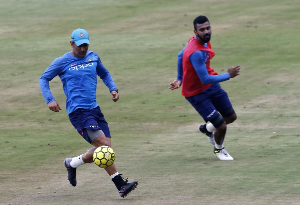 MS Dhoni plays football during a practice session ahead of the 3rd T20 match against Australia at the Rajiv Gandhi International Cricket Stadium in Hyderabad on Oct 12, 2017. - MS Dhoni