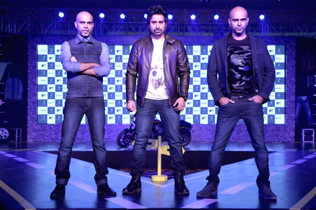 MTV anchor Rannvijay Singh with Television producers Raghu Ram and Rajeev Laxman at the launch of ``VDot Roadies Collection`` in New Delhi Oct 16, 2015. - Rannvijay Singh