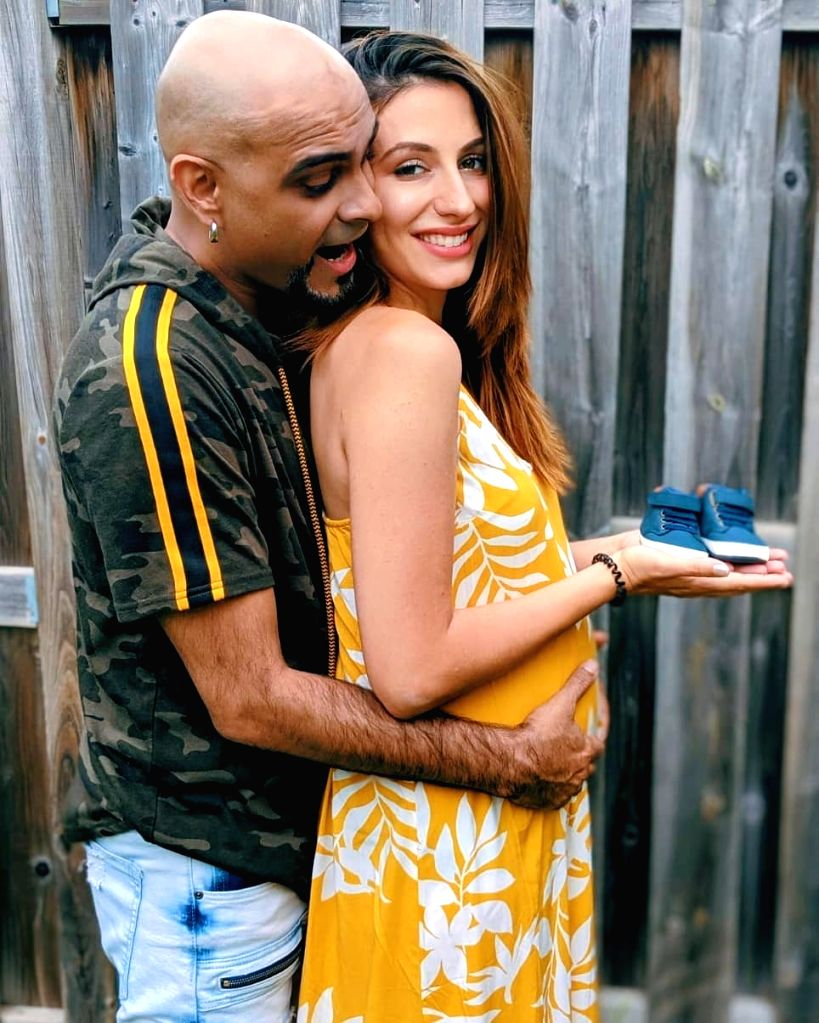 """MTV """"Roadies"""" famed TV producer and actor Raghu Ram and his Canadian singer wife Natalie Di Luccio are """"over the Moon"""" as they are all set to become parents for the first time. Raghu on Sunday shared a picture on Instagram of himself touching his wif - Raghu Ram"""