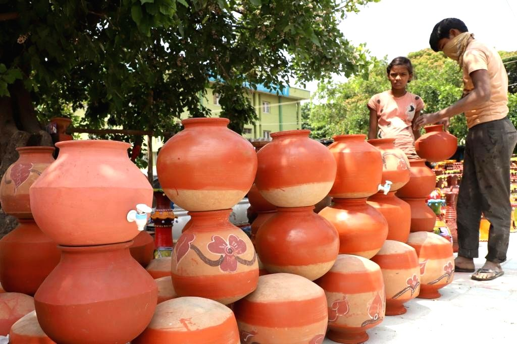 Mud pots at Nagarabhavi, for cooling the water in the blazing Summer, in Bengaluru on Saturday 27th March 2021.