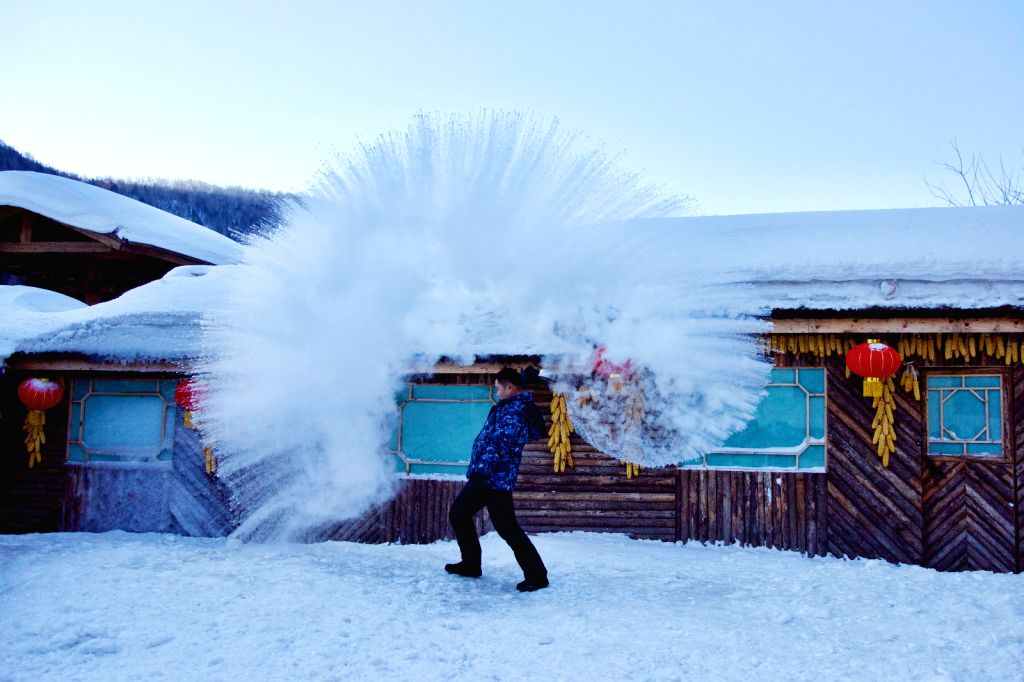 "MUDANJIANG, Jan. 31, 2019 - A tourist plays a ""water to ice"" game by splashing water into the cold air at Shuangfeng Forest Farm in Mudanjiang City, northeast China's Heilongjiang Province, ..."
