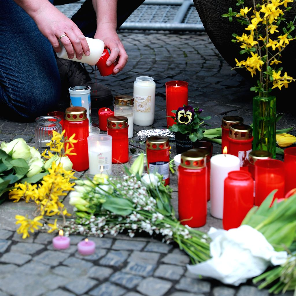MUENSTER, April 8, 2018 - Flowers and candles are seen at the site of the vehicle plowing in Muenster, Germany, on April 8, 2018. Three people including the perpetrator died and a dozen more injured, ...