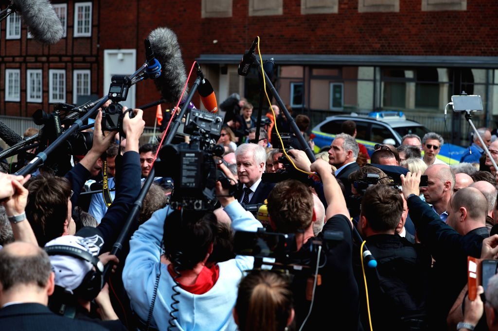 MUENSTER, April 8, 2018 - German Interior Minister Horst Seehofer (C) talks to the media at the site of the vehicle plowing in Muenster, Germany, on April 8, 2018. Three people including the ... - Horst Seehofer