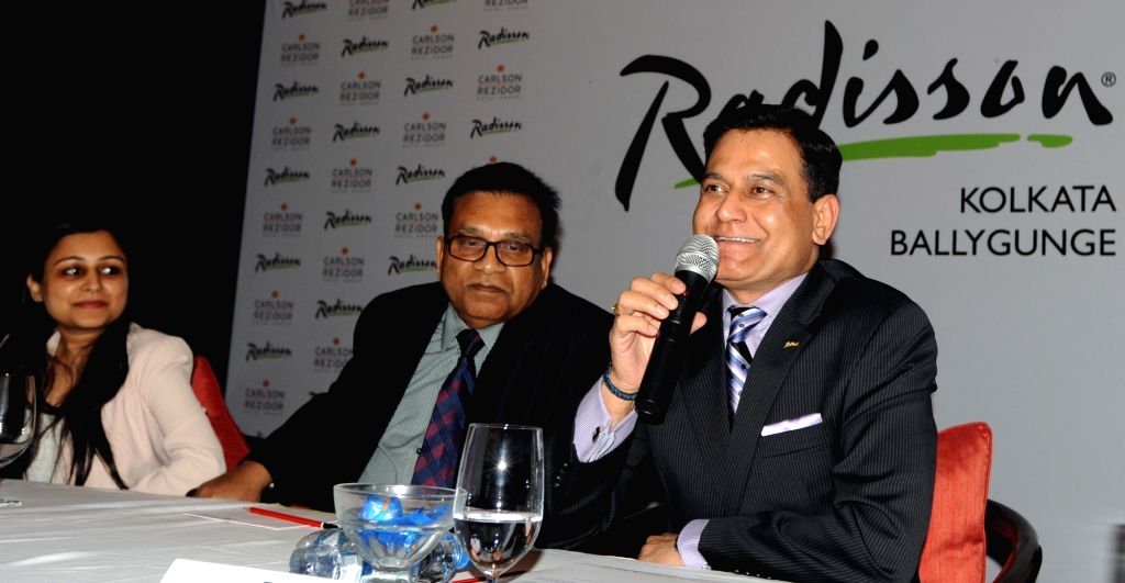 Mukti Gupta Chairman Rajkumar Gupta and Carlson Rezidor South Asia CEO Raj Rana during a press conference in Kolkata on Feb 15, 2018. - Rajkumar Gupta