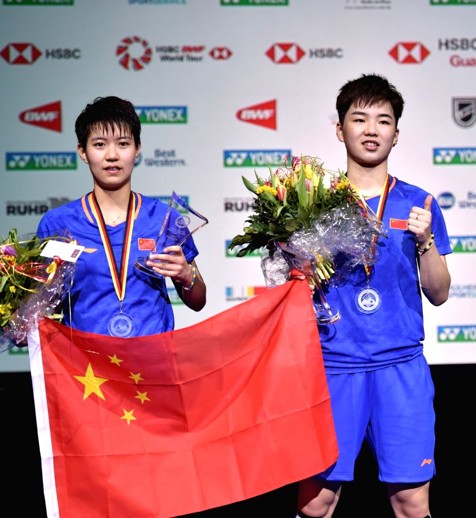 MULHEIM, March 4, 2019 - Du Yue (L) and Li Yinhui of China pose during the medal presenting ceremony after the women's doubles final match against Matsutomo Misaki and Takahashi Ayaka of Japan at the ...