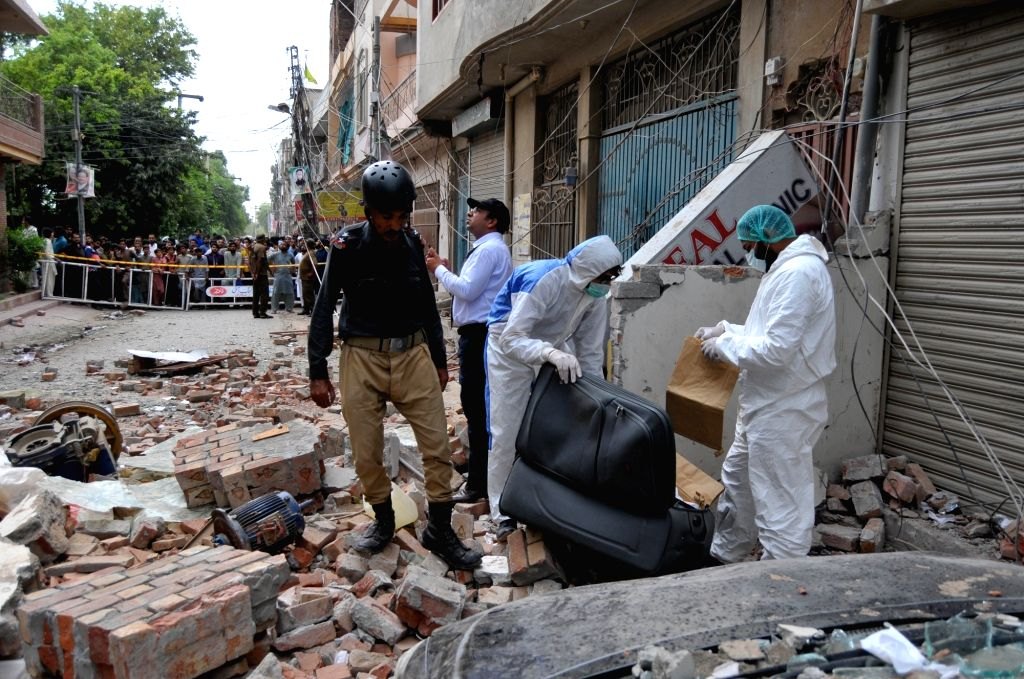 MULTAN, July 16, 2018 - Security officials examine the blast site in central Pakistan's Multan on July 16, 2018. At least three people were killed and 25 others injured when a blast hit a restaurant ...