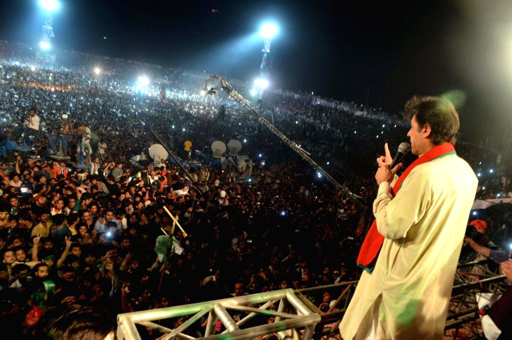 MULTAN, Oct. 11, 2014 (Xinhua) -- Pakistani cricketer-turned politician Imran Khan addresses supporters during a gathering in east Pakistan's Multan on Oct. 10, 2014. At least seven people were killed and 40 others injured in a stampede during the ga - Imran Khan