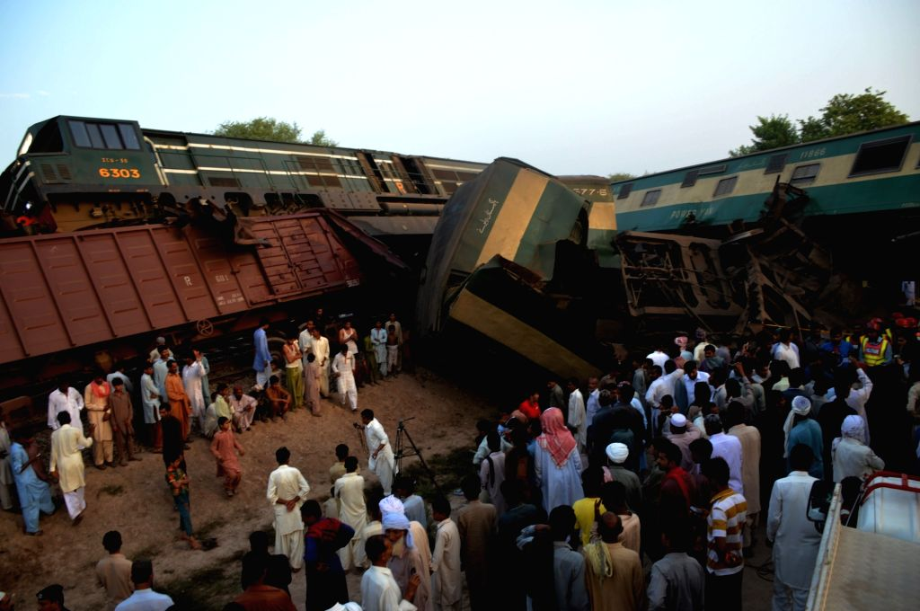MULTAN, Sept. 15, 2016 - Local residents gather at the derailed compartments of a passenger train on the outskirts of central Pakistan's Multan on Sept. 15, 2016. At least six people were killed and ...