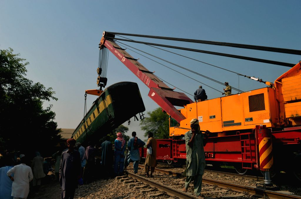 MULTAN, Sept. 15, 2016 - Rescuers work at the train accident site on the outskirts of central Pakistan's Multan on Sept. 15, 2016. At least six people were killed and over 150 others injured when the ...
