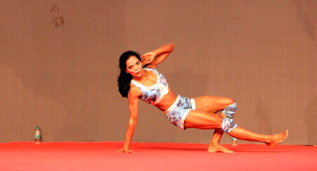 A bodybuilder during the 6th World Bodybuilding and Physique Sports Championship 2014 at Goregaon in Mumbai on Dec 7, 2014.