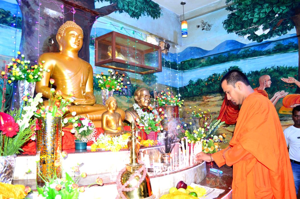 A Buddhist monk offers prayers at a temple on Buddha Purnima in Mumbai, on May 4, 2015.