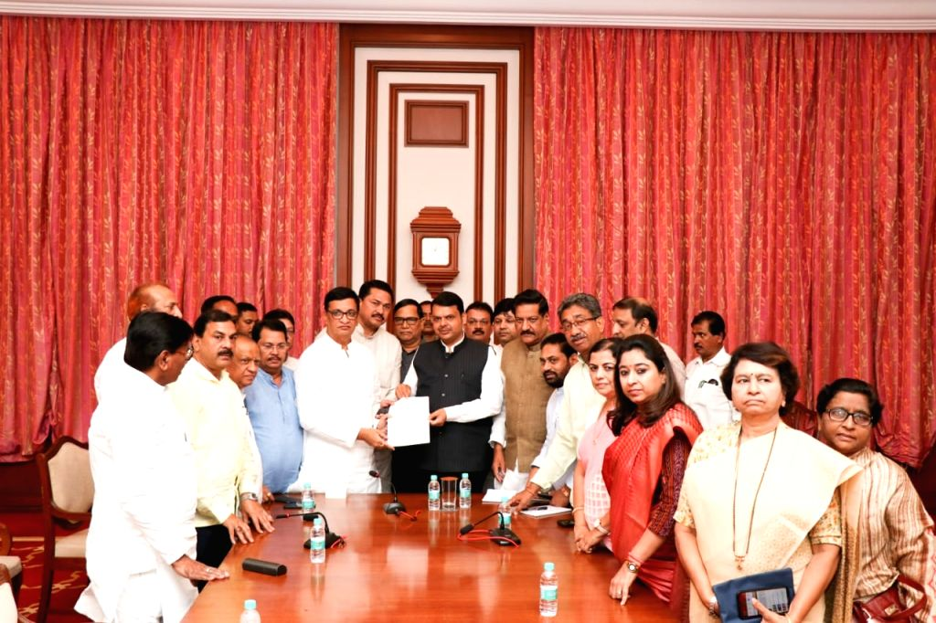 Mumbai: A Maharashtra Congress delegation led by state President Balasaheb Thorat meets Chief Minister Devendra Fadnavis, to urged him to expedite relief measures for the flood-hit in south-western districts in Mumbai on Aug 14, 2019. (Photo: IANS) - Devendra Fadnavis