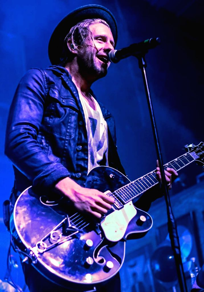 A member of Switchfoot performs during the live performance of the band in Mumbai.