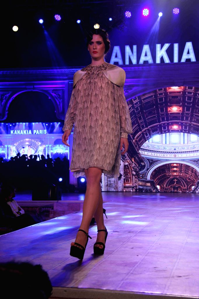 A model walks the ramp for designer Ken Ferns, at a fashion show held by Kanakia Paris, in Mumbai on April 9, 2015.
