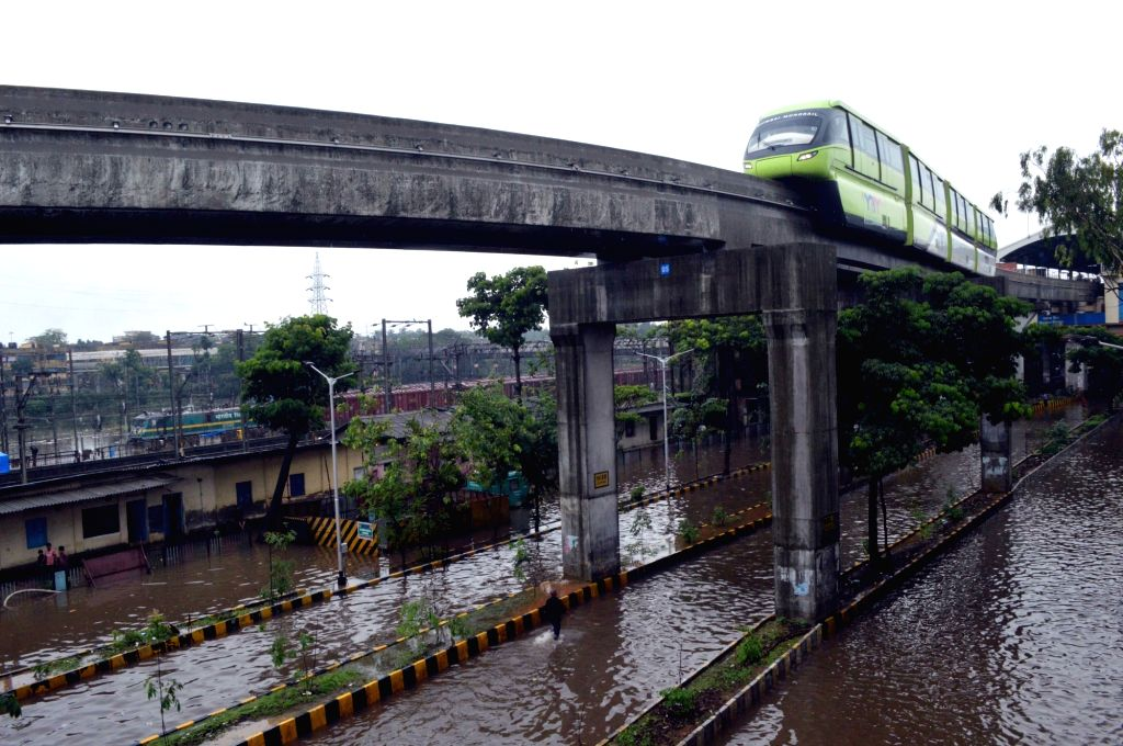 Mumbai: A monorail on the Harbour line seen moving over the inundated streets after heavy rains in Mumbai's Wadala on July 2, 2019. (Photo: IANS)