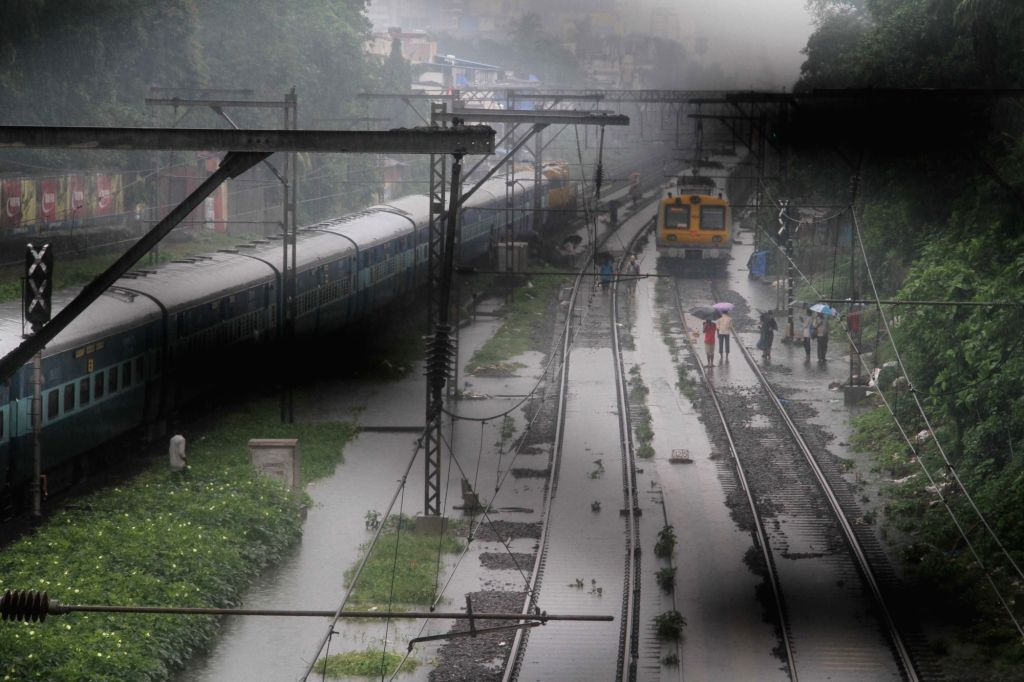 Mumbai: A train halts at Sion Station after heavy rains leave railway tracks water-logged, in Mumbai on July 2, 2019. (Photo: IANS)