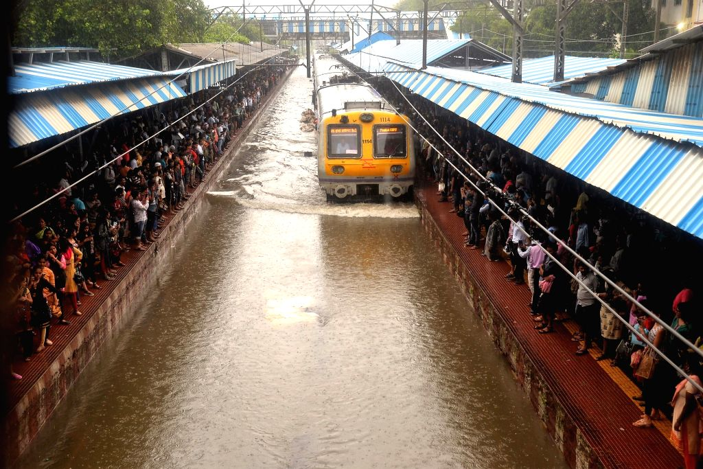 Mumbai: A view of the flooded railway tracks at Mumbai's Sion station during rains, on July 1, 2019. (Photo: IANS)