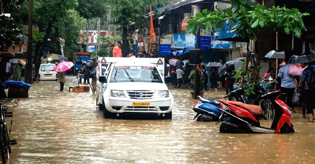 Mumbai: A view of the water-logged Matunga Market after heavy rains in Mumbai, on July 1, 2019. (Photo: K. A. Viswanathan/IANS)