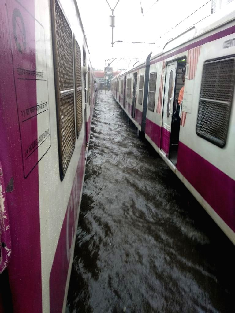 Mumbai: A view of the water-logged railway tracks after heavy rains lashed Mumbai's Andheri on June 28, 2019. Monsoon made a grand entry in Mumbai and surrounding areas on Friday, hitting normal life with the usual woes of water-logging, delays in fl