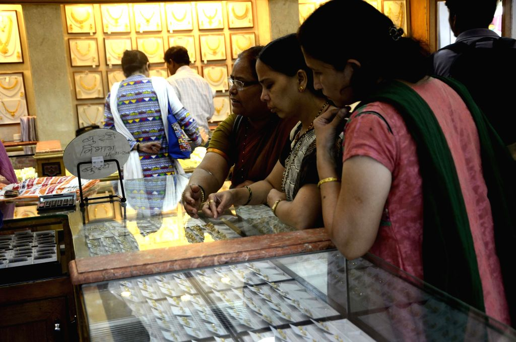 A woman busy shopping at a jewelery store on Akshaya Tritiya in Mumbai, on April 21, 2015.