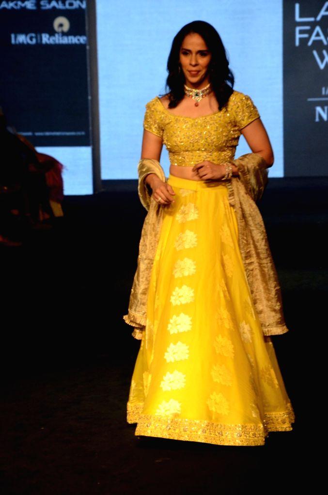 Mumbai: Ace shuttler Saina Nehwal showcases fashion designer Vaani Raghupathy's creation during Lakme Fashion Week (LFW) Summer/Resort 2019 in Mumbai on Feb. 2, 2019. (Photo: IANS)