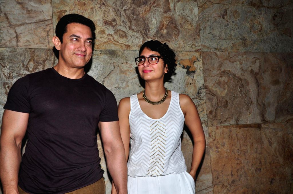 Actor Aamir Khan along with his wife and filmmaker Kiran Rao during the special screening of documentary film After My Garden Grows in Mumbai, on Nov. 14, 2014. - Aamir Khan and Kiran Rao