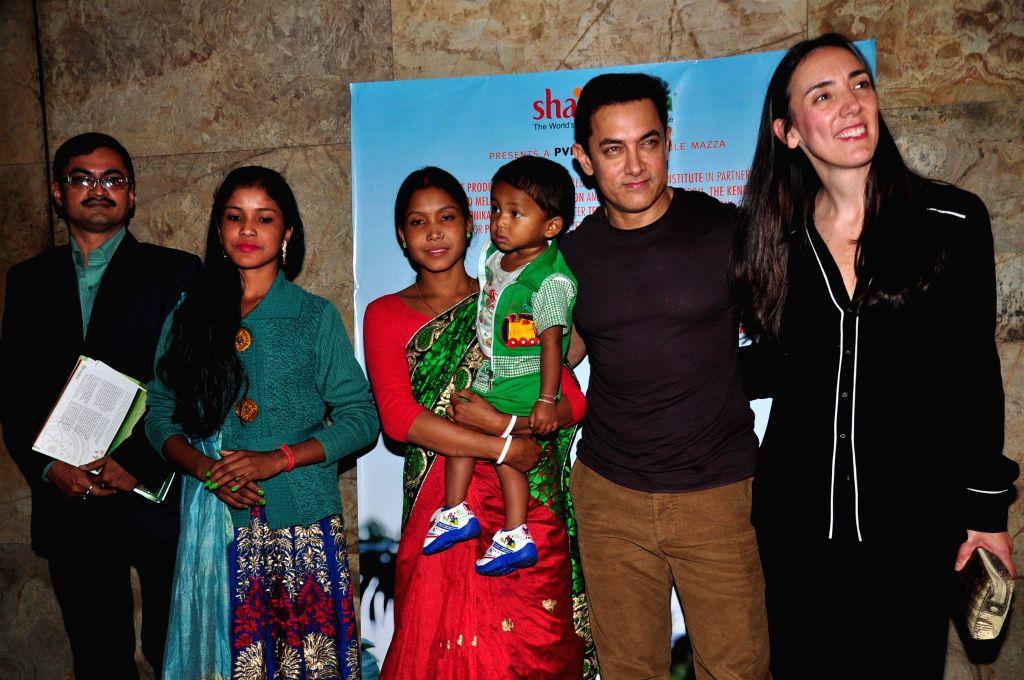 Actor Aamir Khan and American documentary filmmaker Megan Mylan during the special screening of documentary film After My Garden Grows in Mumbai, on Nov. 14, 2014. - Aamir Khan