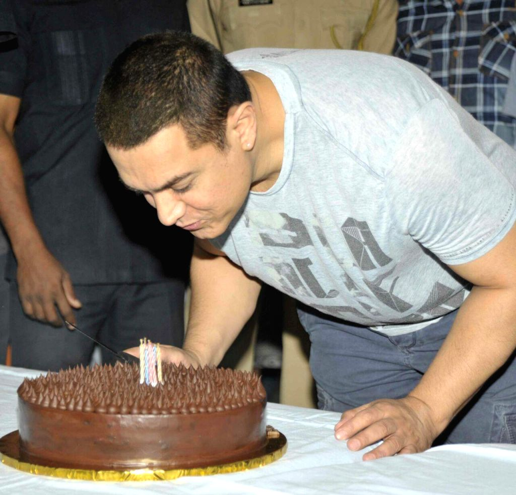 Actor Aamir Khan celebrates celebrates on the eve of his birthday in Mumbai, on March 13, 2015. - Aamir Khan