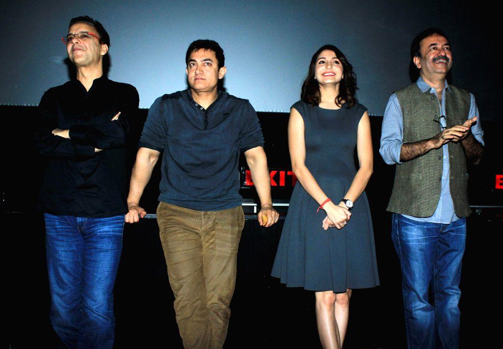 Actor Aamir Khan, filmmaker Vidhu Vinod Chopra, actor Anushka Sharma and filmmaker Rajkumar Hirani during special screening of film PK organised for the Mumbai Police officials in Mumbai on .. - Aamir Khan, Vidhu Vinod Chopra and Anushka Sharma