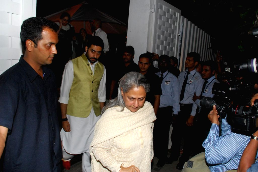 Actor Abhishek Bachchan along with his mother Jaya Bachchan during the condolence meeting organised in the memory of late filmmaker Ravi Chopra in Mumbai, on Nov 15, 2014. - Abhishek Bachchan and Jaya Bachchan