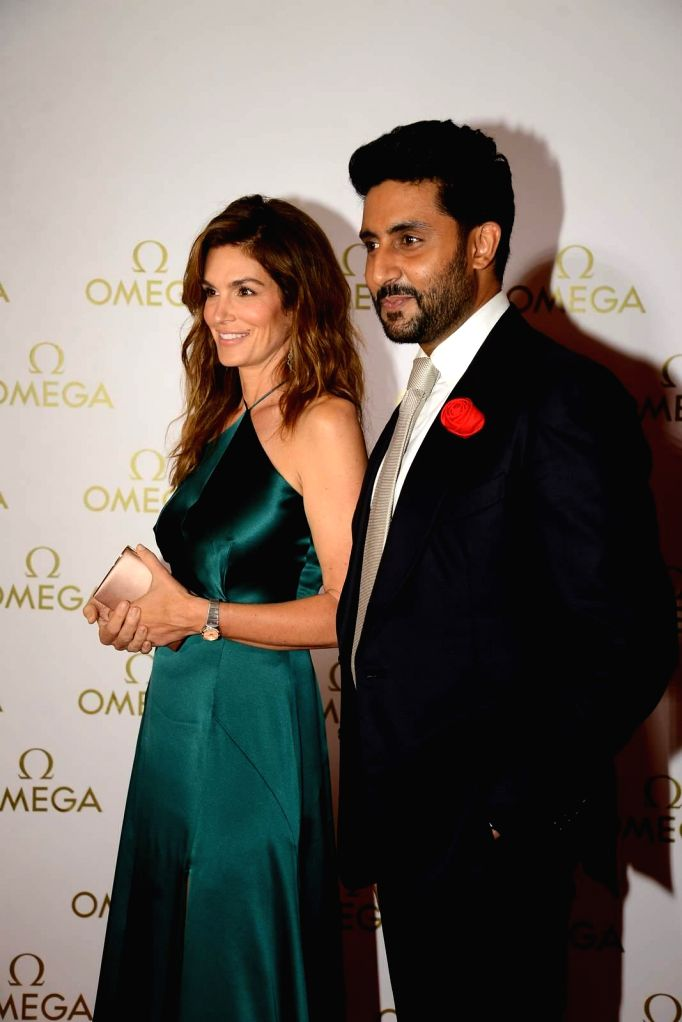Actor Abhishek Bachchan and American model Cindy Crawford during the party organised for the launch a product in Mumbai, on June 18, 2015. - Abhishek Bachchan